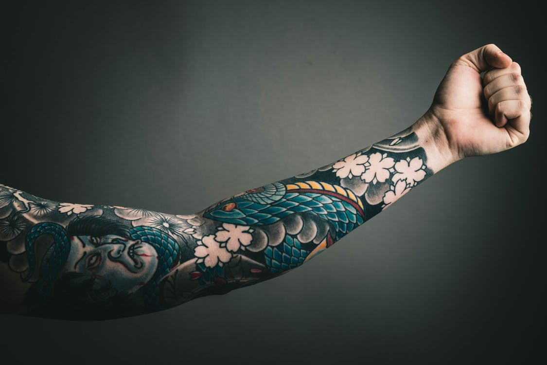 Man's arm with tattoo sleeve