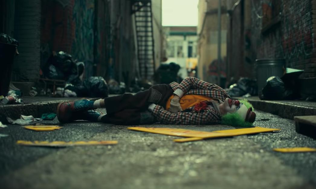 Joker lying in street