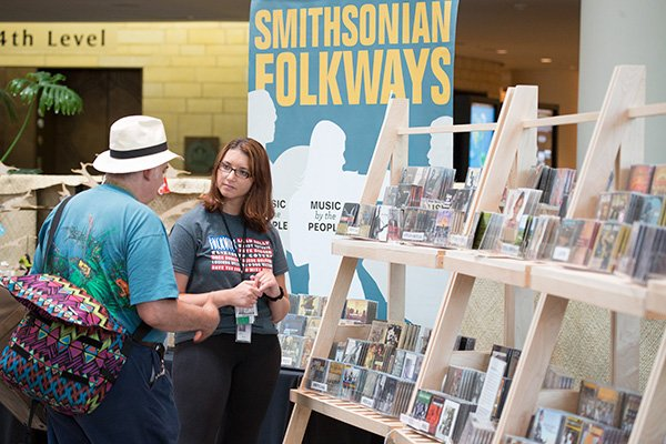 people browsing records at smithsonian folklife festival