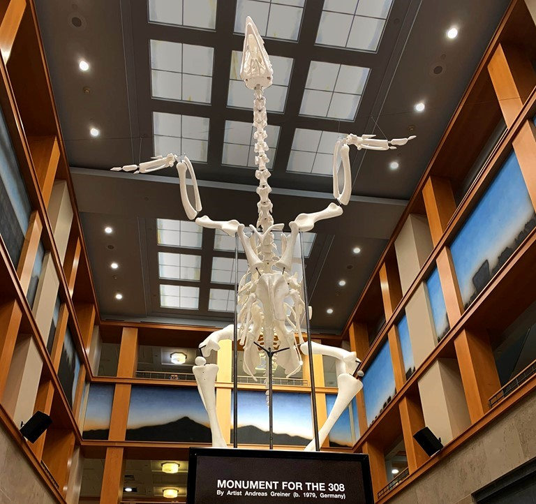 monument for the 308, giant skeleton at denver public library