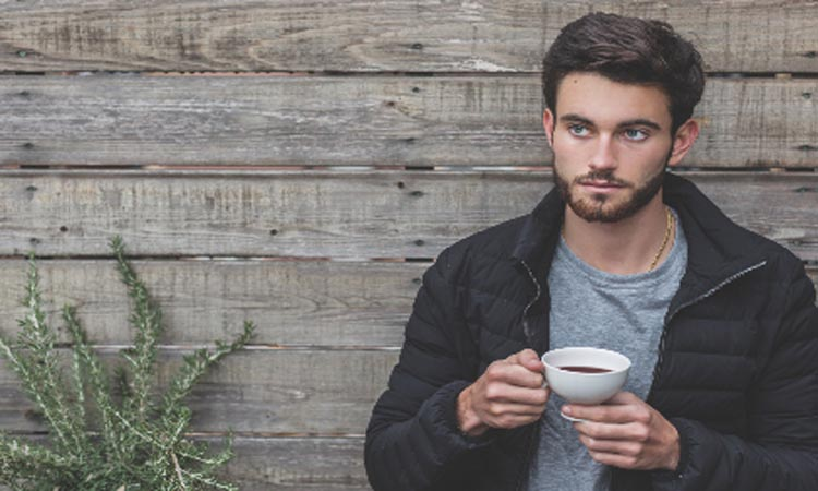 Young man drinking a cup of coffee.