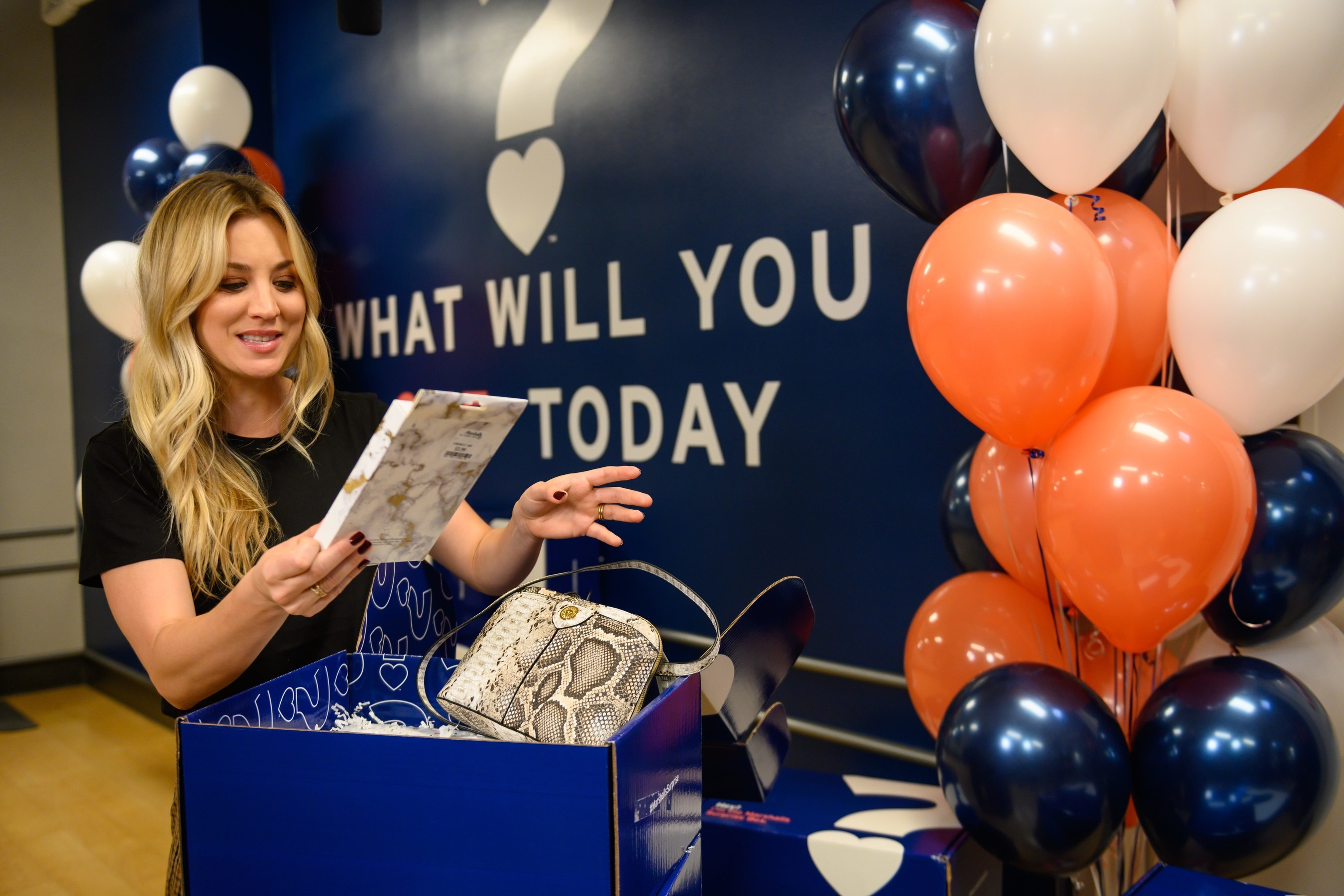 Kaley Cuoco unveiling a Marshalls Surprise Box