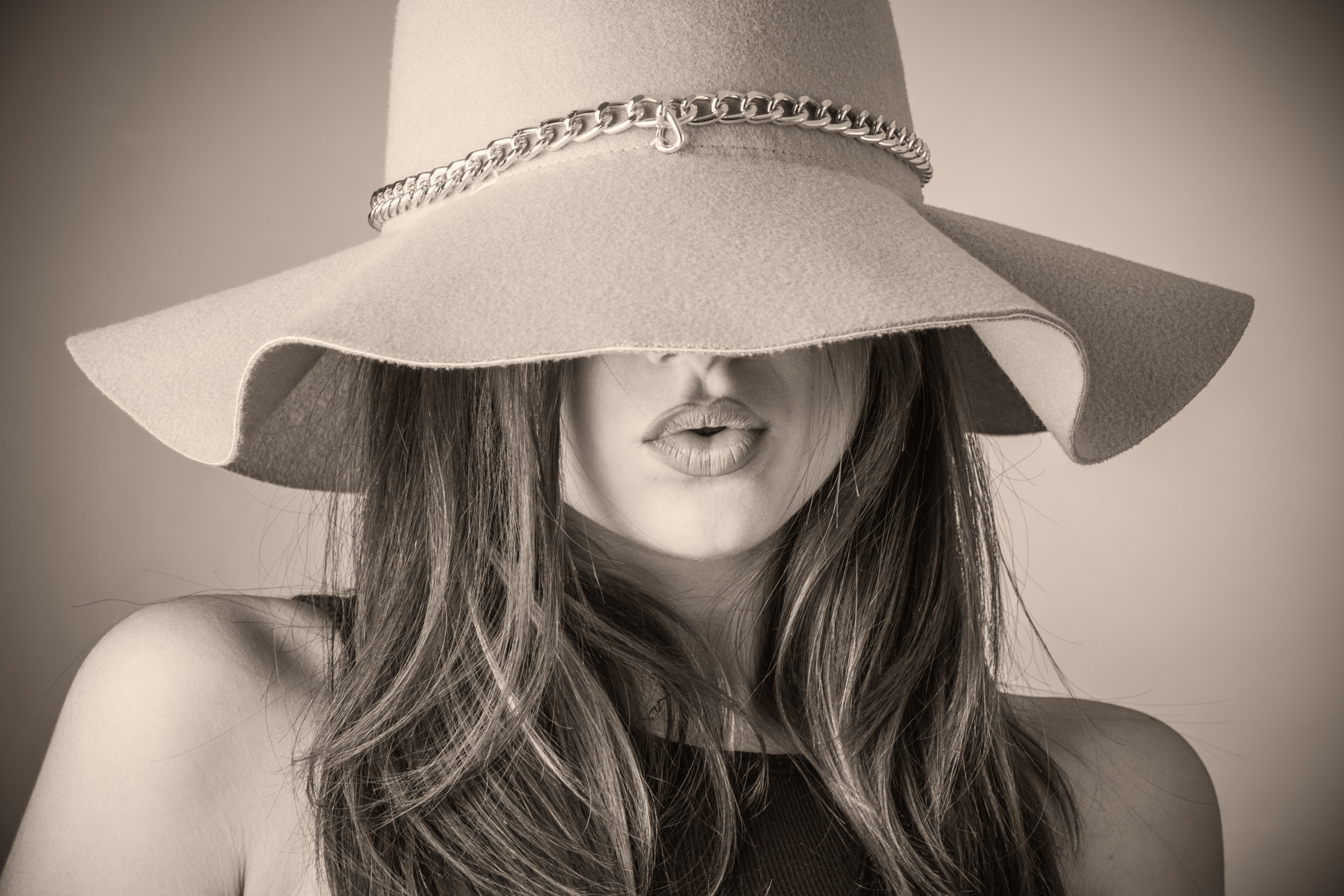 woman's face covered by a hat