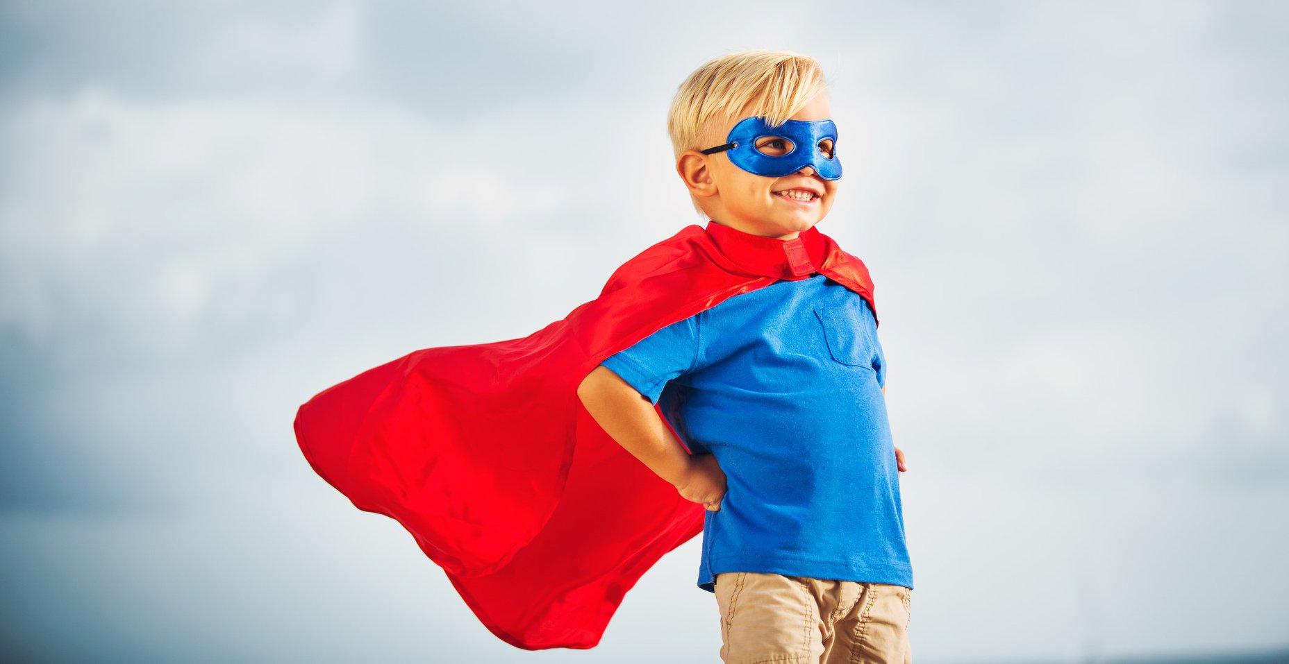 little boy in superman cape