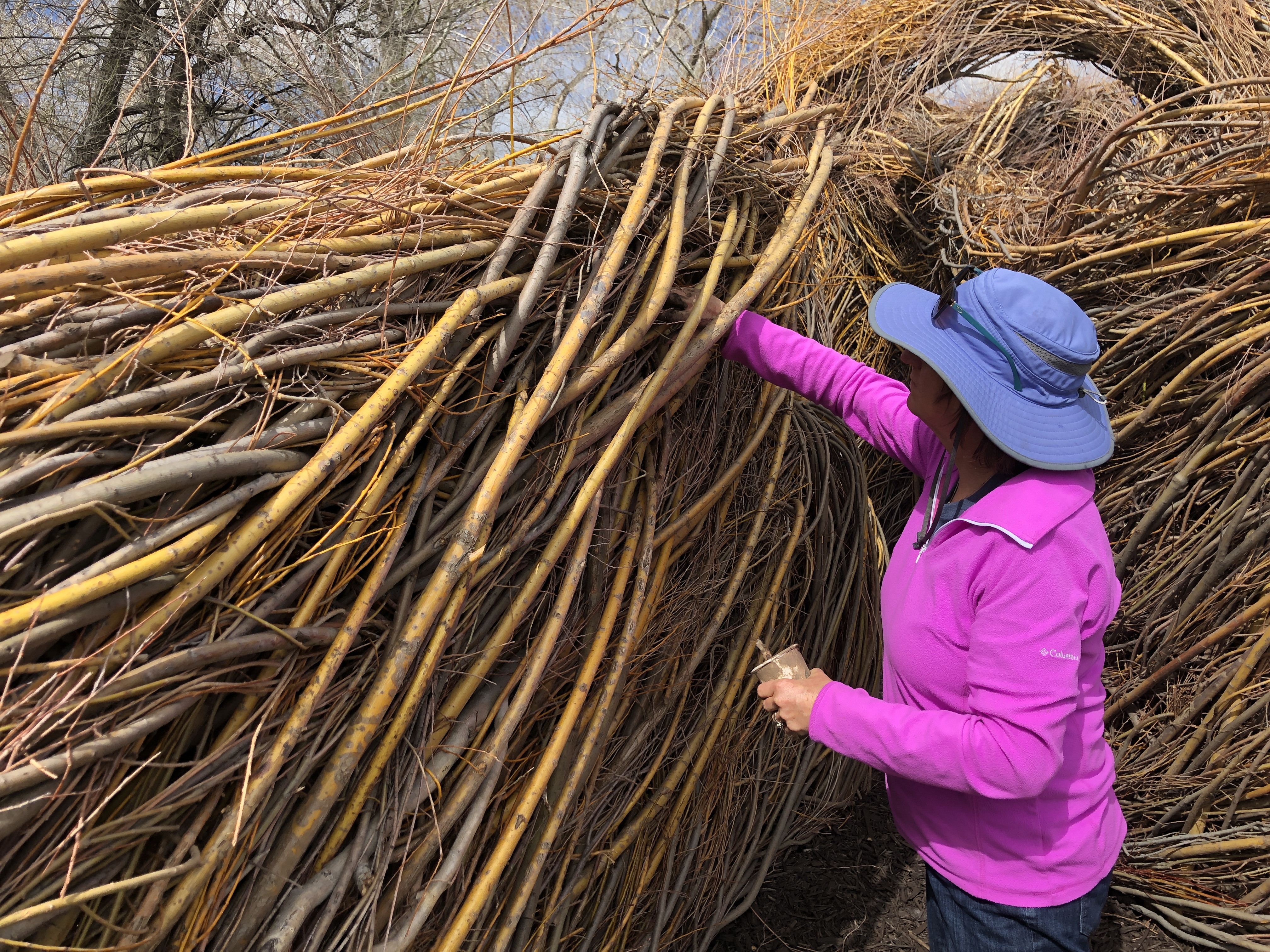 Volunteers work on sculpture at Chatfield Farms