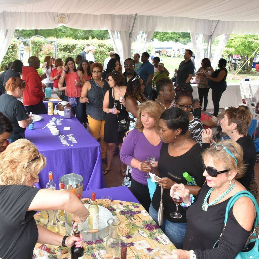 attendees sampling beverages at arts, wine, and jazz festival
