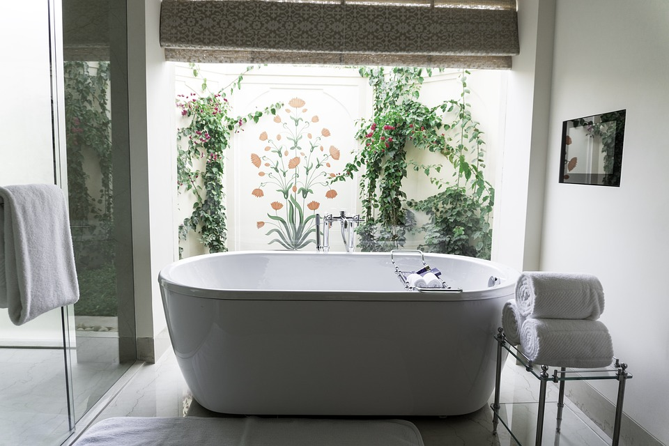 bathtub, towels, opening to garden