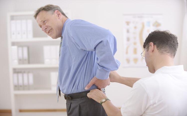 chiropractor adjusting back