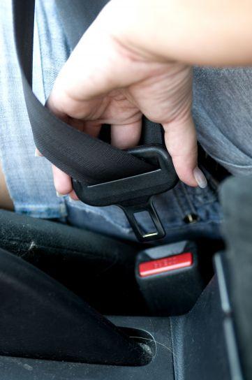 person using a seatbelt