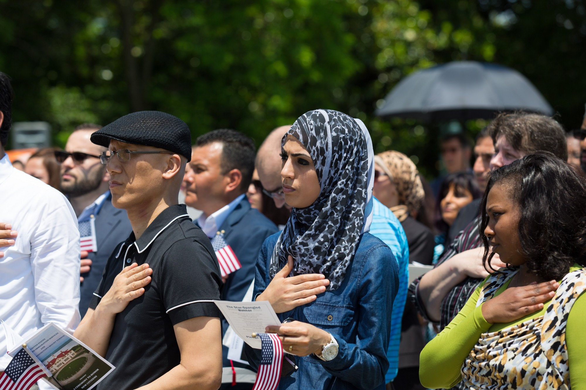 woman in crowd during naturalization ceremony at mount vernon