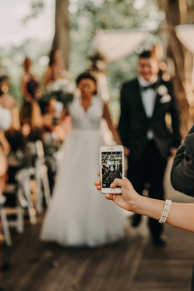 Ashtyn Brooke Photo, wedding guest with iphone blocking picture