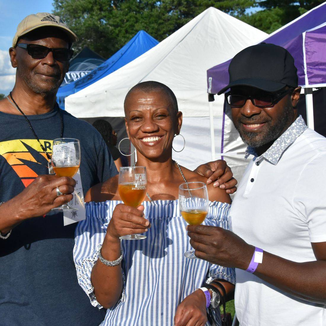 guests smiling with drinks at festival