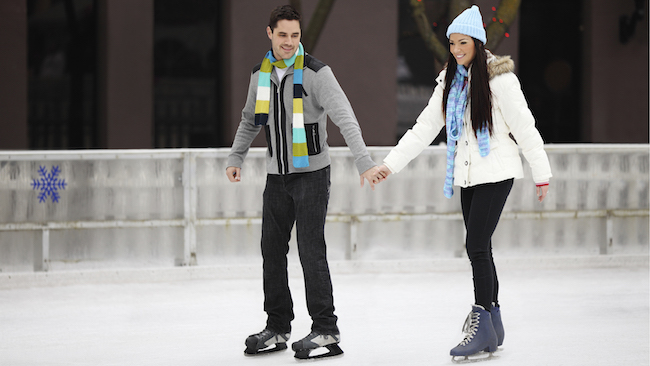 a man and woman ice skating
